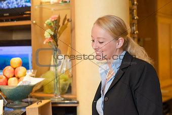 Beautiful blond hotel receptionist