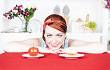 Smiling woman choosing between tomato and cake