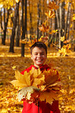 happy smiling boy with autumn leaves