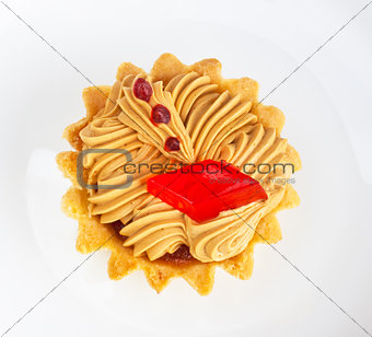 cake with fruit jelly on white dish