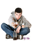 Young man with a glass of whiskey