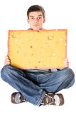 Surprised young man holding yellow board