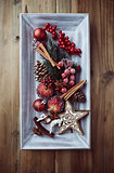 Rustic christmas decorations on a wooden tray