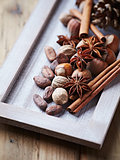 Spices, nuts and cocoa beans for christmas baking
