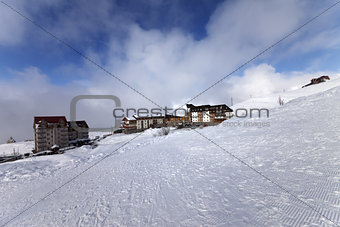 Houses and hotels on ski resort, view from ski slope
