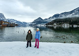 Children near alpine winter lake