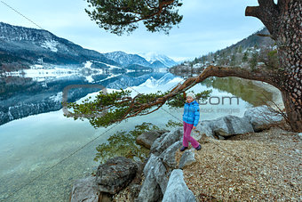 Alpine winter lake view and girl