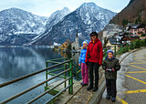 Family in Hallstatt town  (Austria). Winter view.