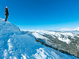 Woman on winter mountain top