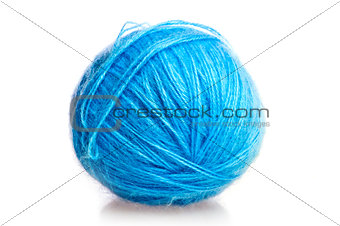 blue ball of woolen threads on a white background