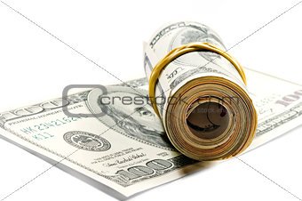 roll of dollar bills on the hundred dollar bill