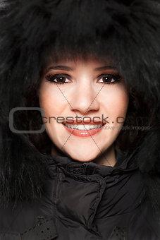 Beautiful woman with black hood