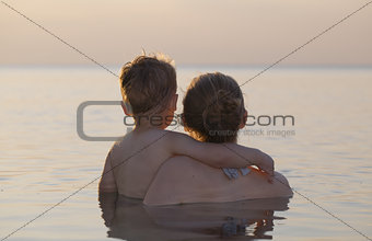 Mother and son watching the sunset
