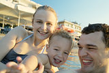 Happy young family at the seaside