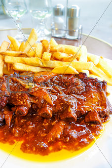 Grilled meat ribs on the plate