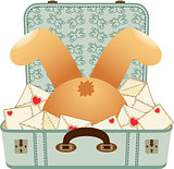 Teddy bear upside down in the love letter suitcase