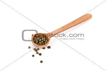 green pepper in wooden spoon