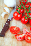 fresh tomatoes, garlic and old knife