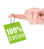 female hand showing hundred percent cotton tag