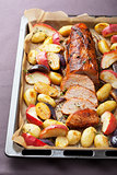 pork baked with vegetables on a tray
