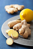 fresh ginger root and lemon on vintage plate