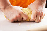 man hands kneading dough