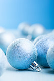 blue christmas balls over blurred background