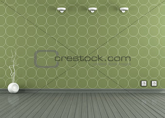 Empty room with green wallpaper