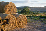 Summer countryside landscape of stack of hay bales against rural