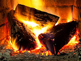 burning fuelwood in fireplace