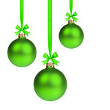 composition from three green christmas balls hanging on ribbon