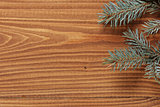 blue spruce twig on wooden plank