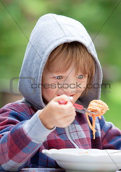 Boy Eating Pasta