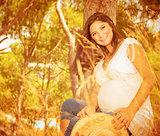 Expectant female on backyard