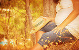 Pregnant girl in autumnal park