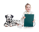 kid playing doctor with dog isolated on white