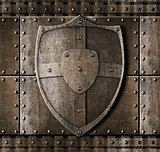 metal shield over armour background with rivets
