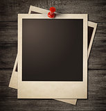 polaroid photo frames pinned to wooden grunge wall background