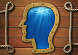 The inner world concept. Head porthole on wooden wall and sea or