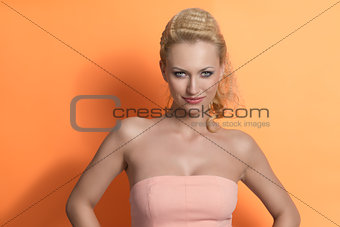 smiling blonde girl on colorful background