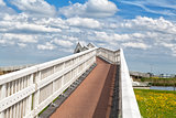 white bridge over blue sky with beautiful clouds