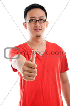 Thumb up good looking young Southeast Asian male