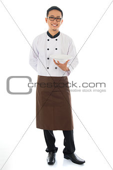 Asian chef holding an empty plate