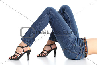 Woman legs with jeans and sandal heels isolated