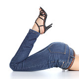 Woman legs with jeans and sandal heels