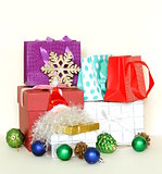 many gift boxes and colorful shopping bags on white background