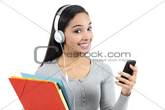 Arab student listening to the music and holding folders