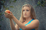 Eve in Paradise, taking the apple