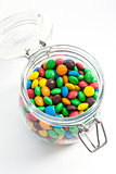 Colored candy in a glass jar