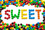 The word sweet, made from colored candies